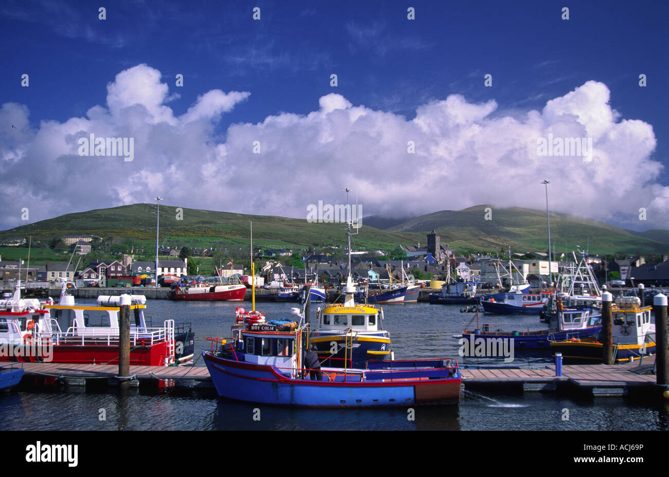 Fishing boats and trawlers moored in in Dingle Harbour. County Kerry, Ireland. - Stock Image