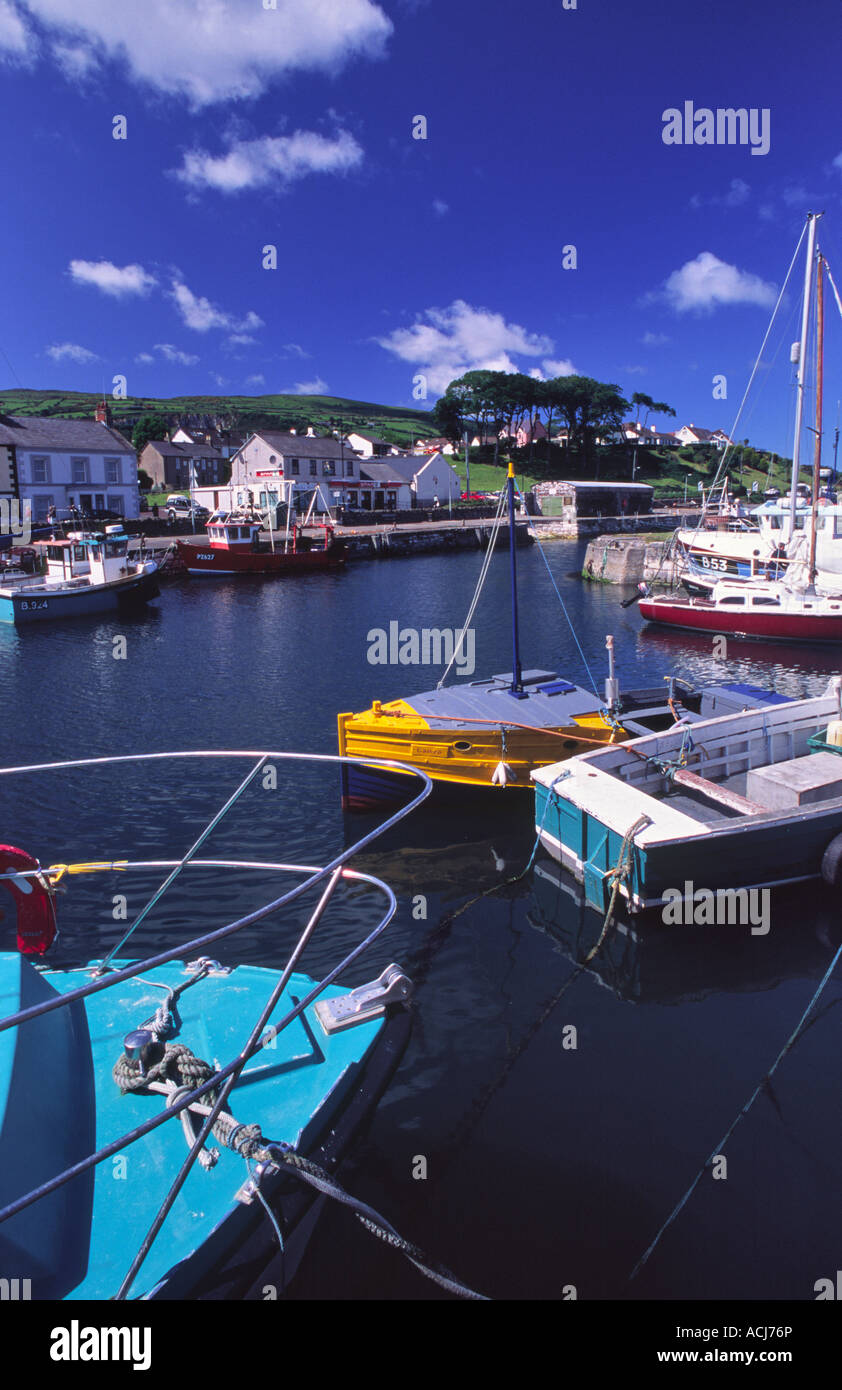 Summer fishing boats in Carnlough Harbour, Glens of Antrim, County Antrim, Northern Ireland, UK. - Stock Image