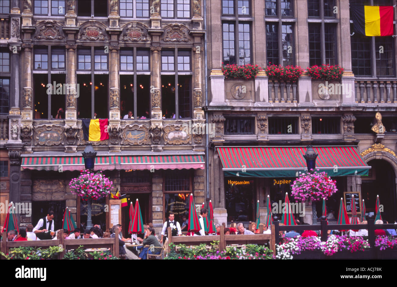 Diners in the old cafes of the Grand Place, Brussels, Belgium. Stock Photo