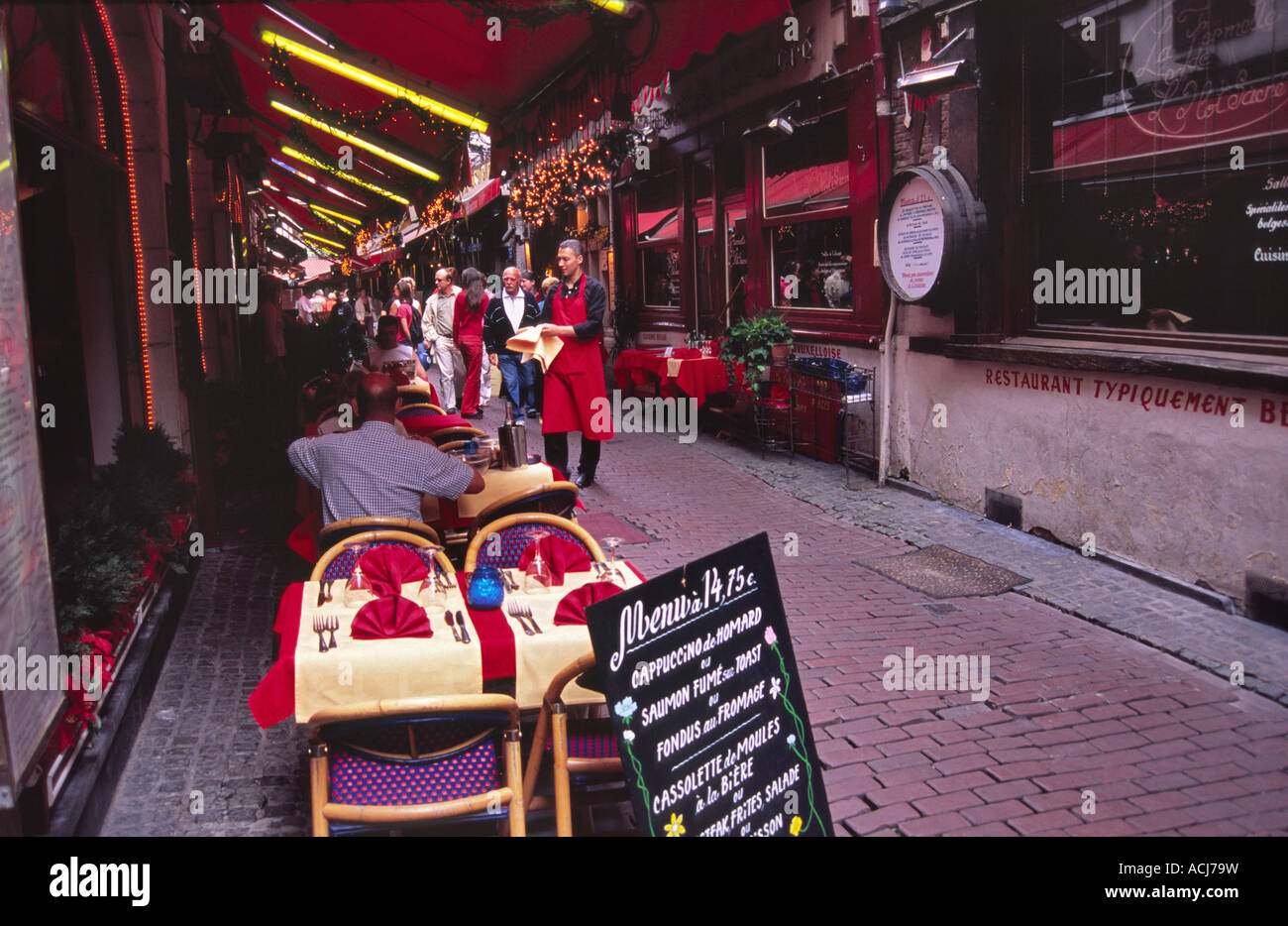 Street dining in a restaurant near the Grand Place, Brussels, Belgium. - Stock Image