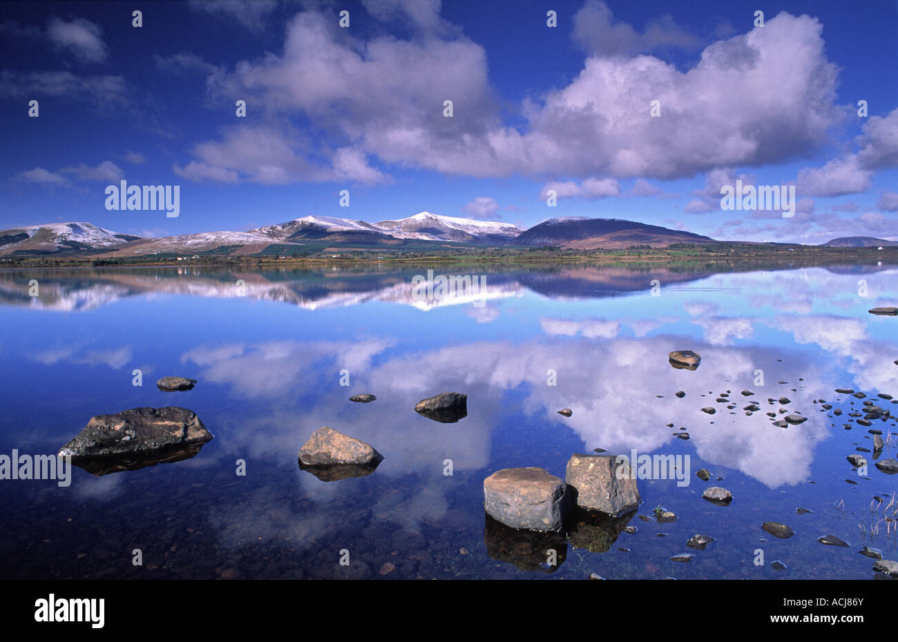 Snow capped Nephin Beg Mountains reflected in Beltra Lough, County Mayo, Ireland. - Stock Image