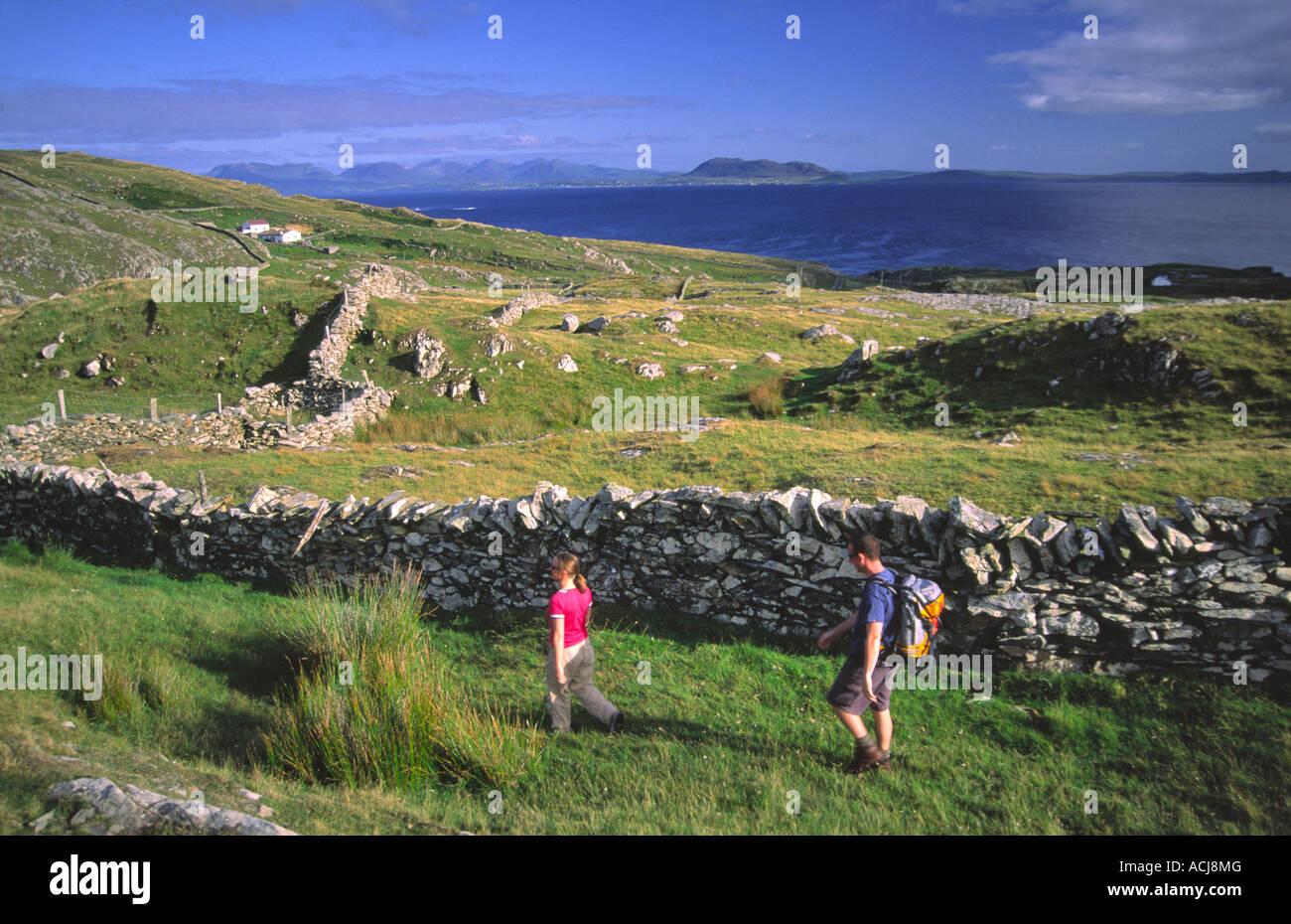 Walkers exploring Inishturk Island, County Mayo, Ireland. - Stock Image