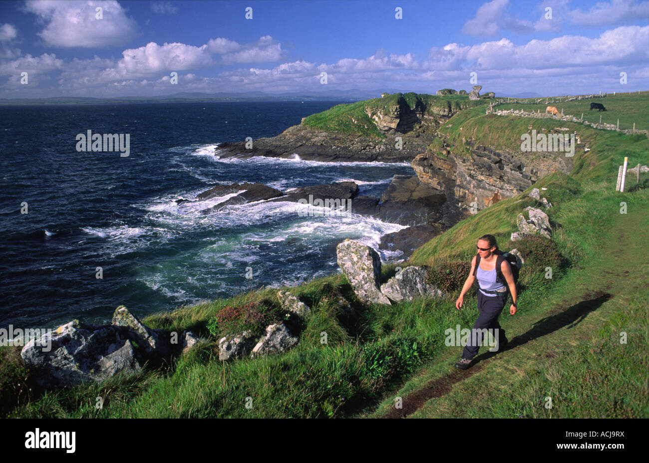 Walker in front of Kilbarron Castle, on the Creevy Coastal Path from Rossnowlagh to Ballyshannon. County Donegal, Stock Photo