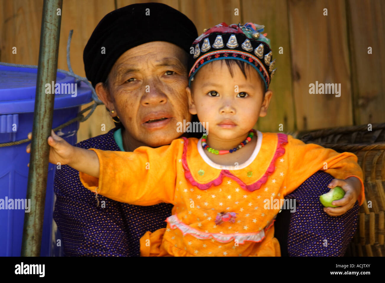 Old woman with young girl at the market of Bacha, Vietnam Stock Photo