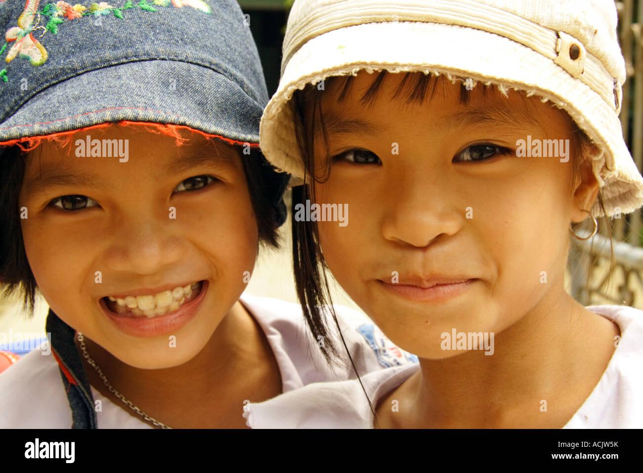 Portrait of two young Vietnamese schoolgirls Stock Photo