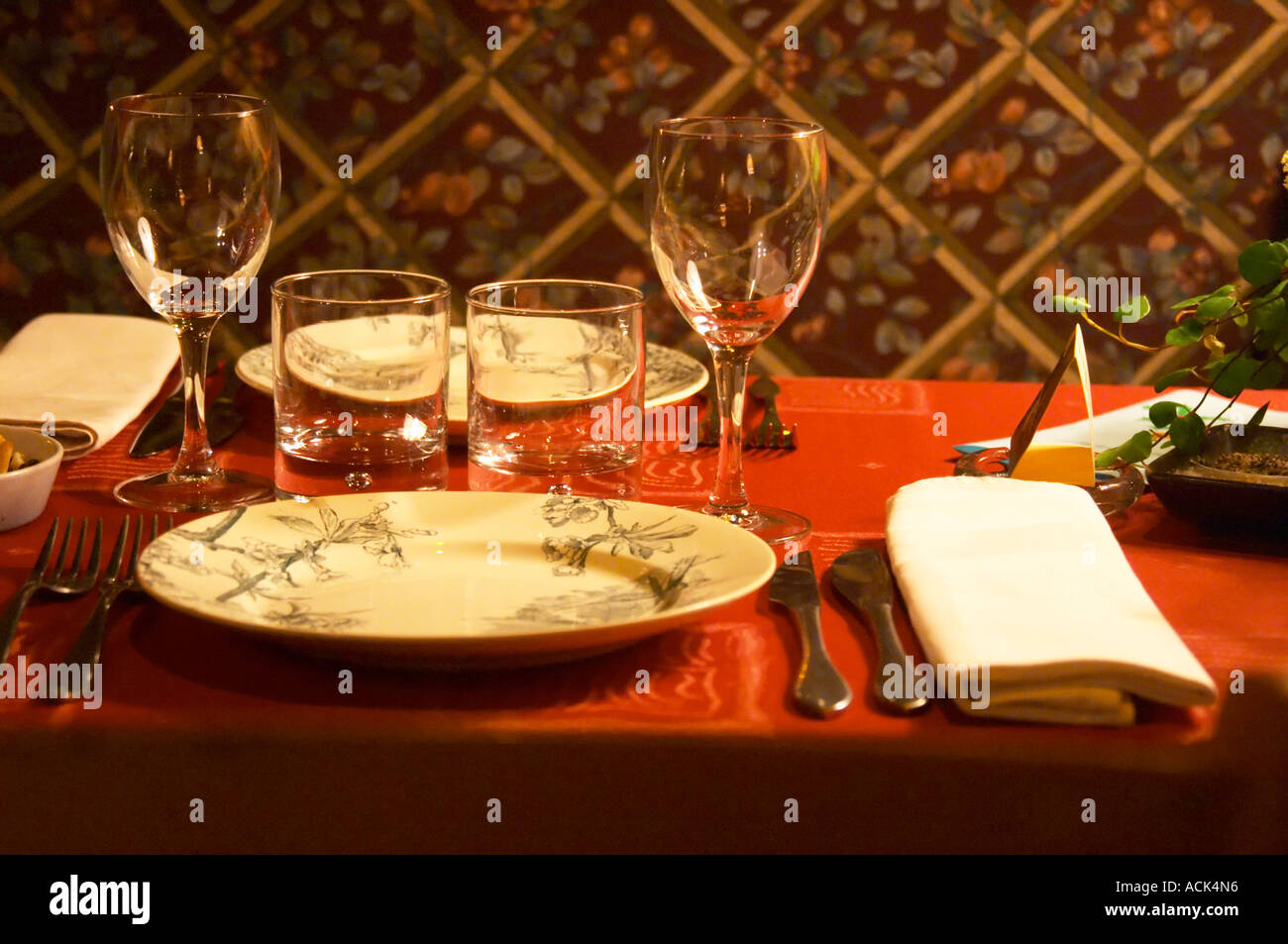 Dining Table Set For Two With Plates, Glasses, Silver Wear, Linen Napkin  And A Red Table Cloth. At The Gastronomic Restaurant Lu0027Enfance De Lard  Bergerac ...
