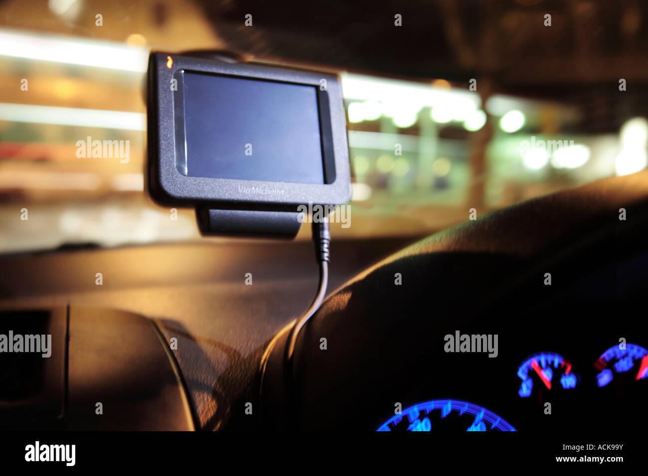sat nav unit in a car at night. - Stock Image