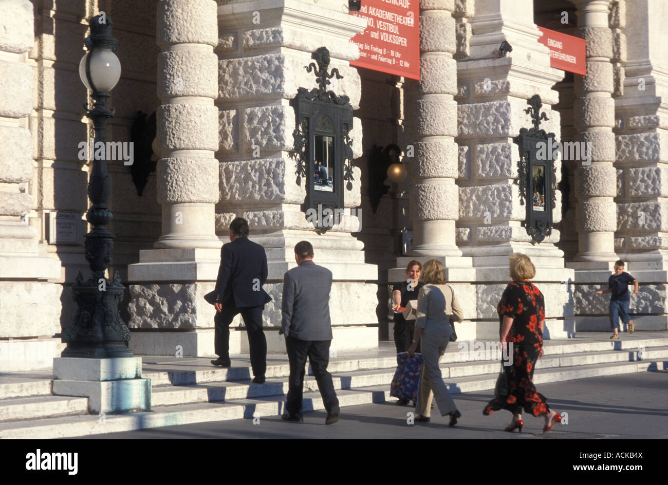 Theatre goers going into Burgtheater theatre in Vienna Austria - Stock Image