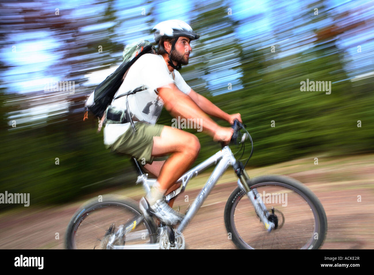 Man on mountain bike with blurred background Stock Photo