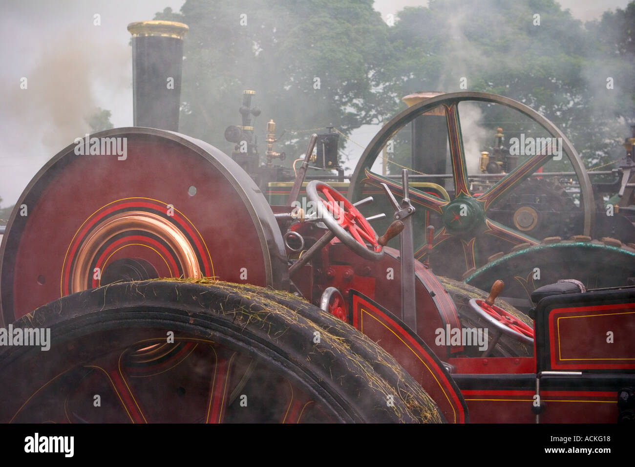 Steam engine rally - showing smoking fly-wheels soon after engines started, Scotland. Stock Photo