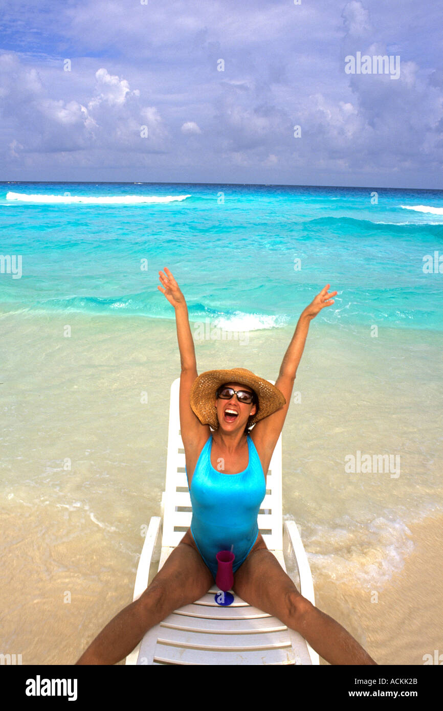 Young Hispanic Woman On Lounge Chairs The Beaches Of Cancun Mexico