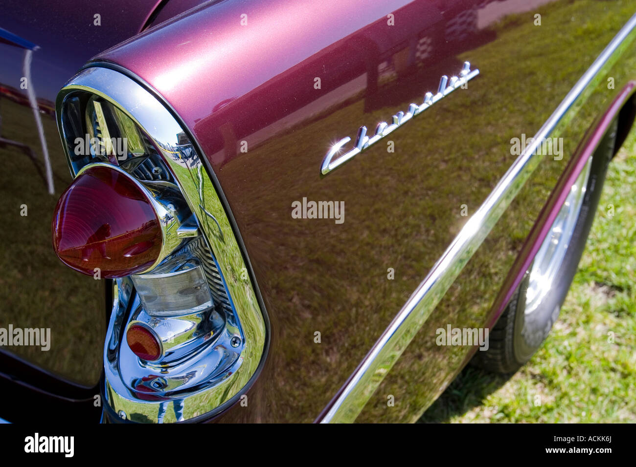 Tail Light Fin And Name Plate On The Side Of A Maroon Chevrolet Bel Air Classic Car At An Auto Show