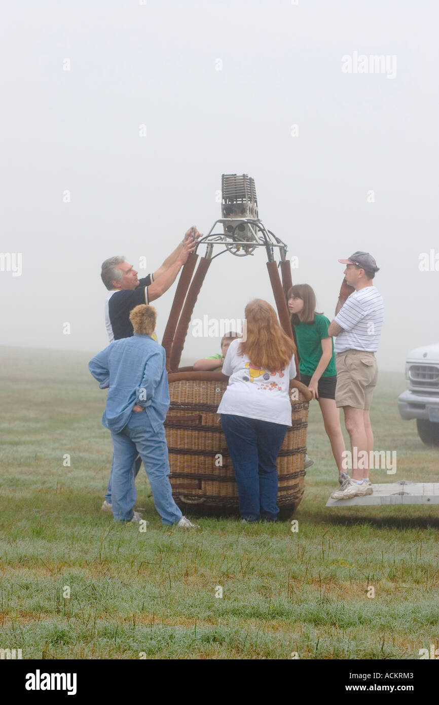 Hot air balloon crew waiting for fog to lift at balloon festival in Dunnellon, Florida, USA Stock Photo