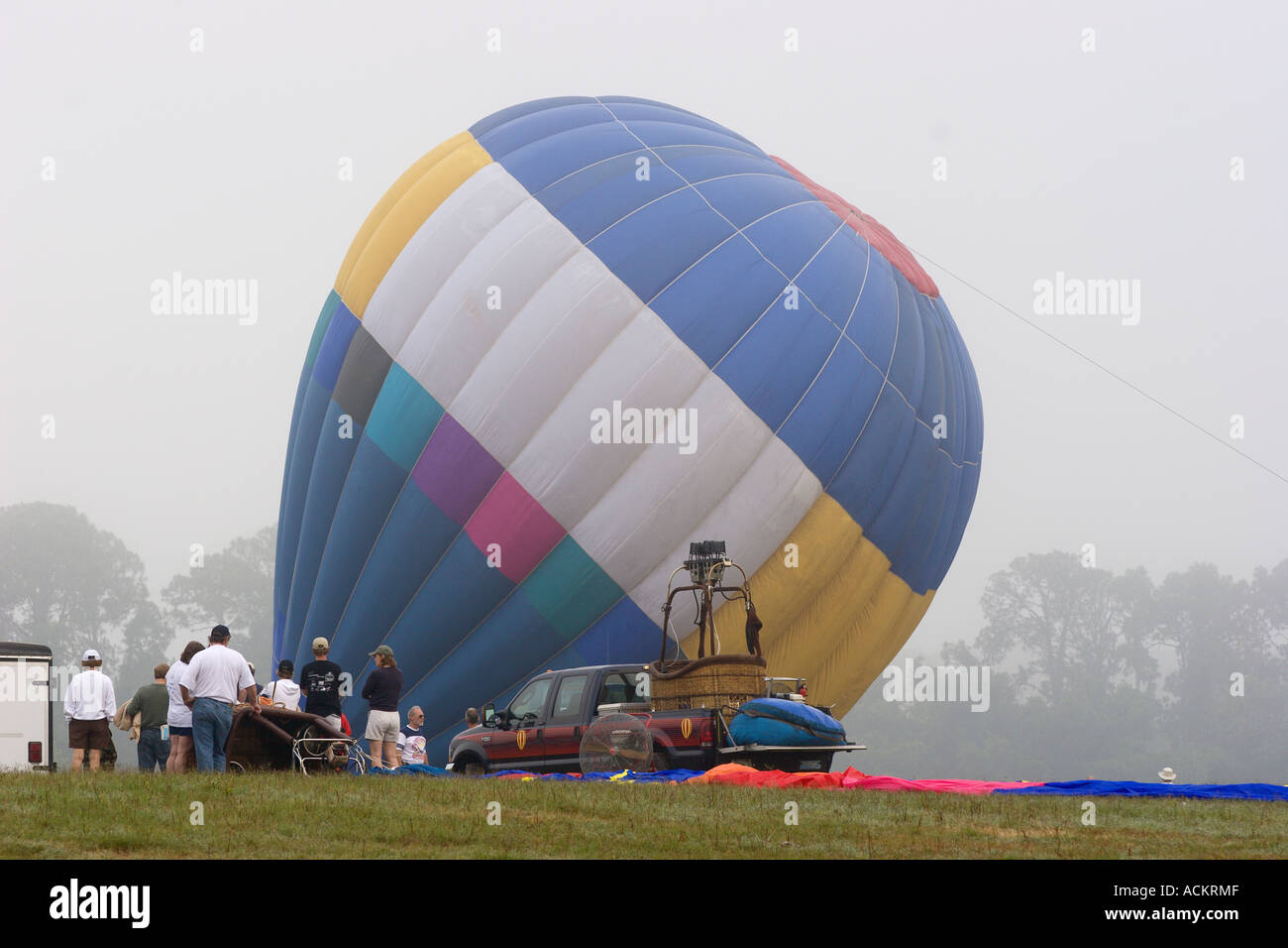 Hot air balloon being inflated on a foggy morning at balloon festival in Dunnellon, Florida, USA Stock Photo