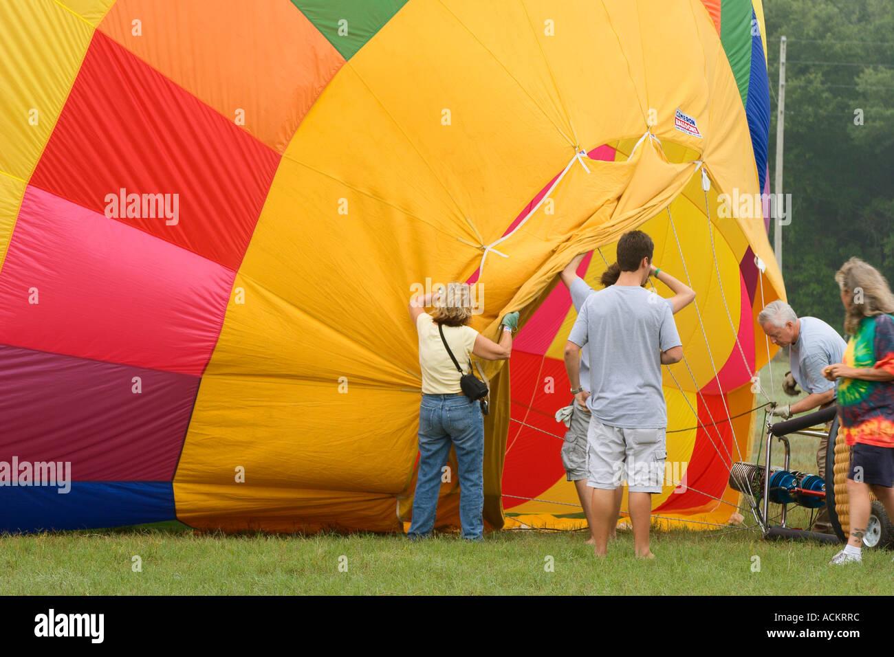 Yellow hot air balloon prepare for lift off at balloon festival in Dunnellon, Florida, USA Stock Photo