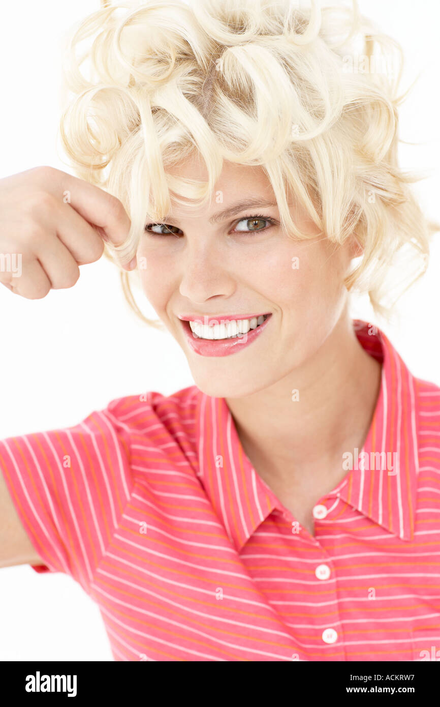 A young woman doing her hair - Stock Image