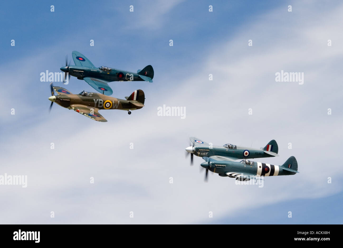 Preserved World War Two Royal Air Force Hurricane and Spitfire fighters formation display at RAF Fairford - Stock Image