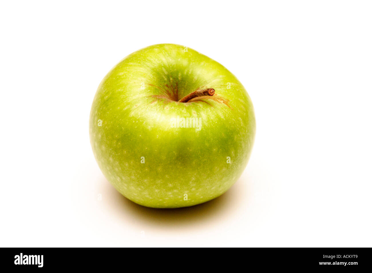 Green apple on a white background - Stock Image