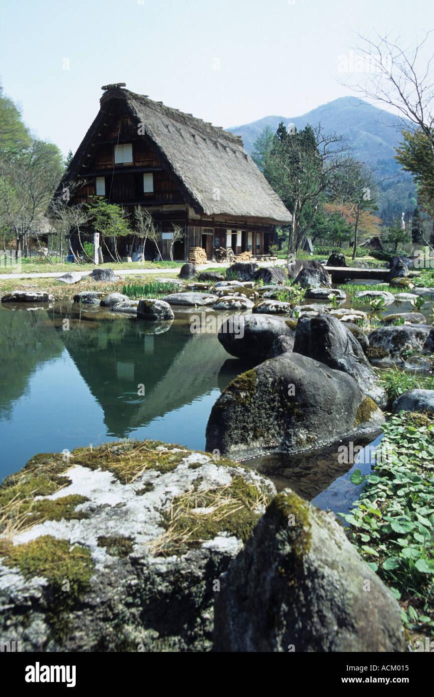 House and lake Shirakawa go Japan - Stock Image