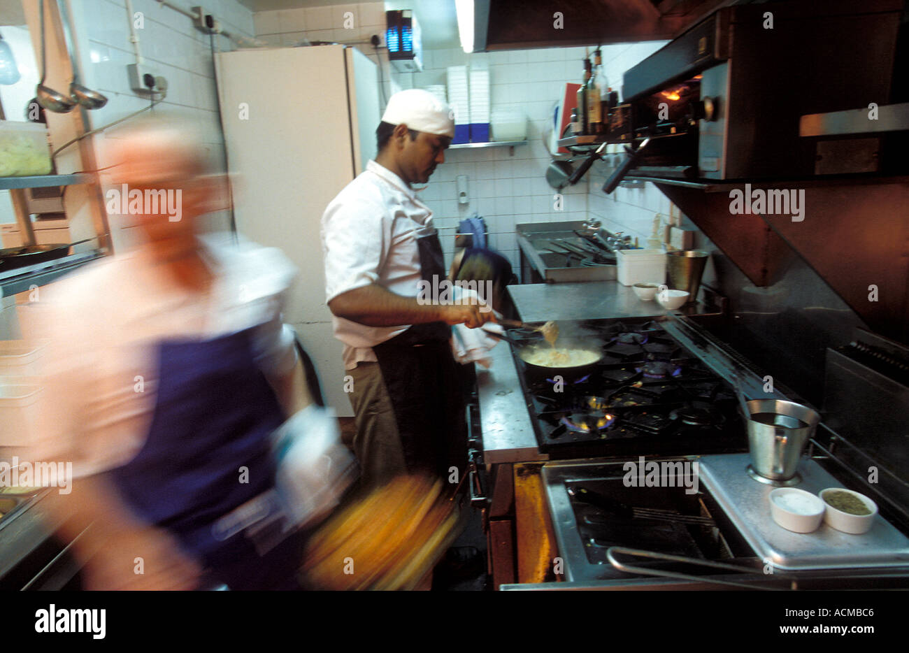 Scotland Glasgow Chefs at work in the kitchen of the Arisaig a trendy restaurant serving modern Scottish cuisine - Stock Image