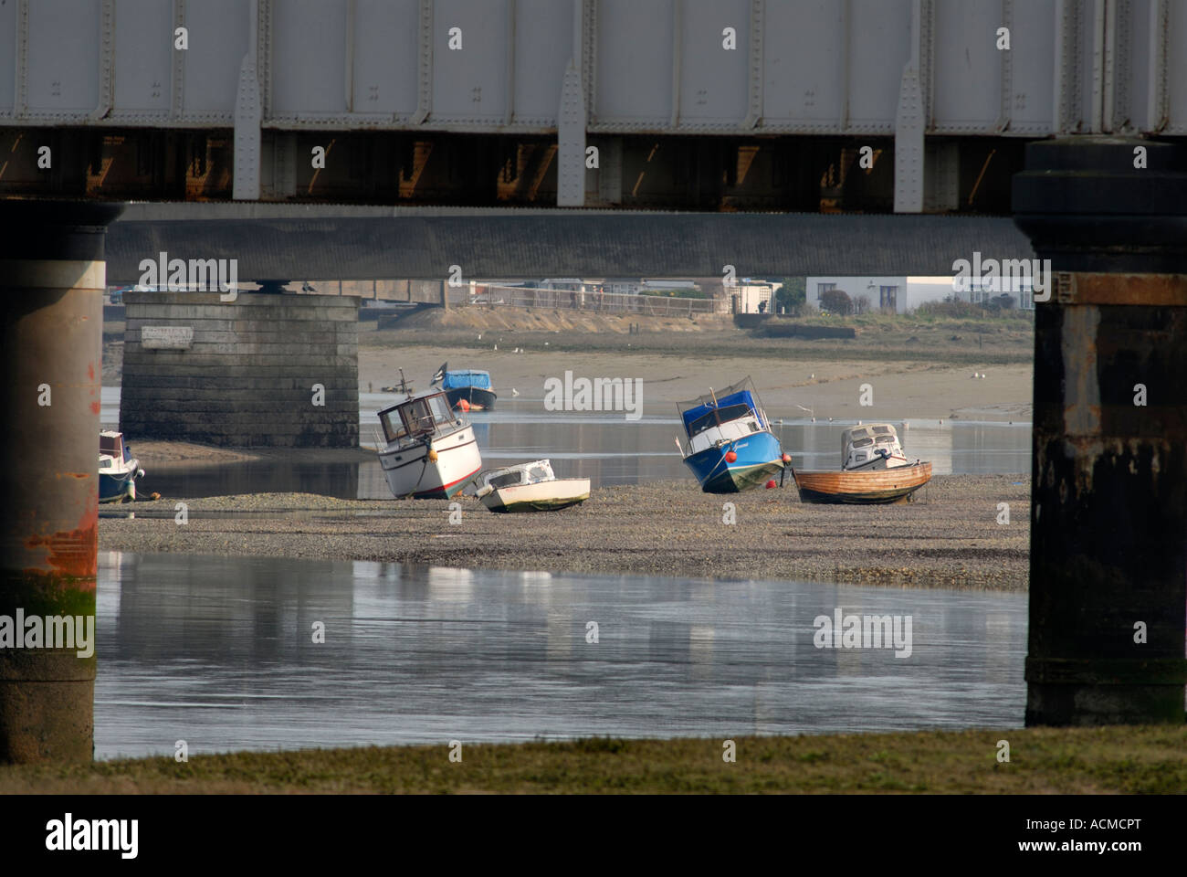Boats on the River Adur at Shoreham by Sea West Sussex UK Picture framed by columns on railway bridge Stock Photo