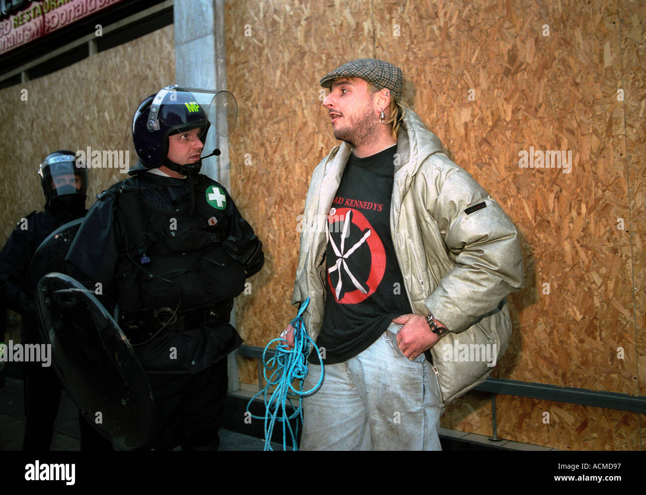 police and demonstrator confronting each other at mayday demonstration in central London - Stock Image