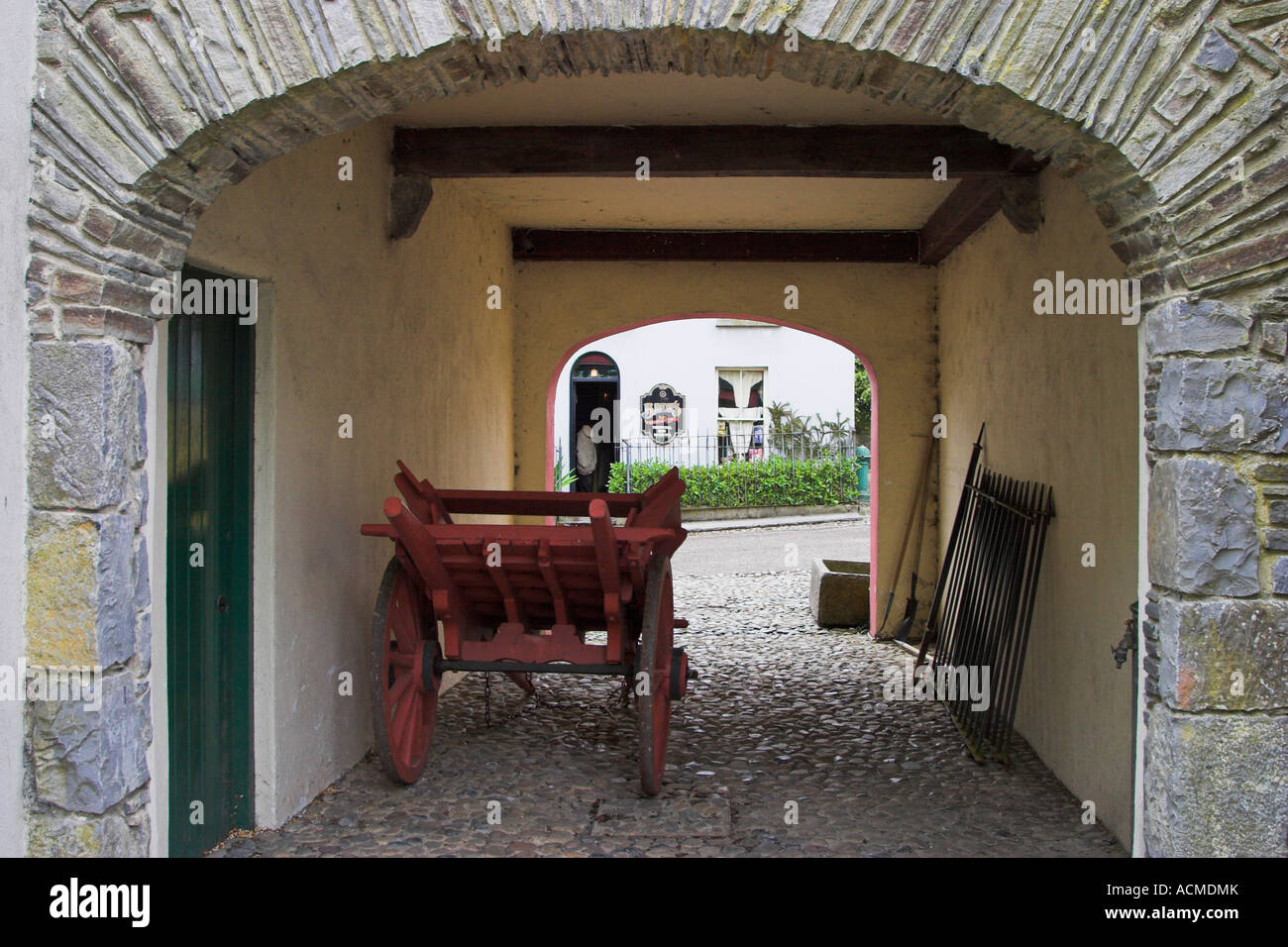 A covered alley with cart in Bunratty Folk Park Co Clare Ireland - Stock Image