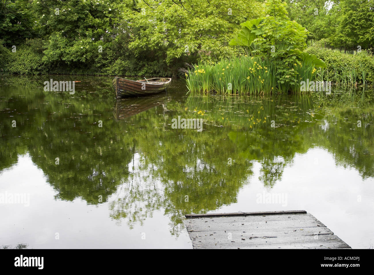 Rowing boat in a pond at Bunratty Folk Park Co Clare Ireland Stock Photo
