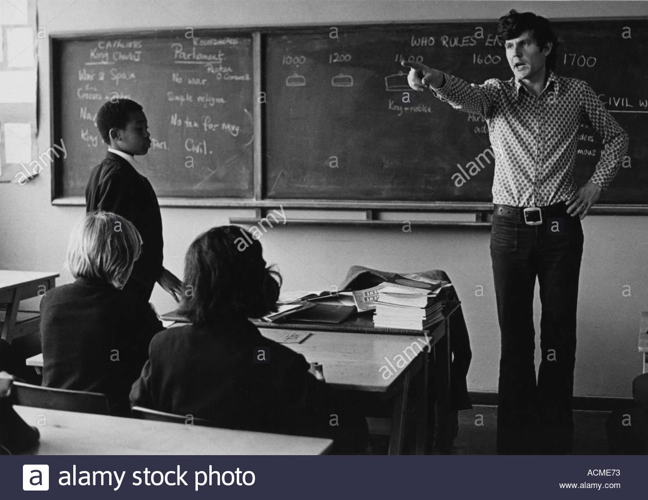Secondary school teacher getting angry at disruptive children in the classroom - Stock Image