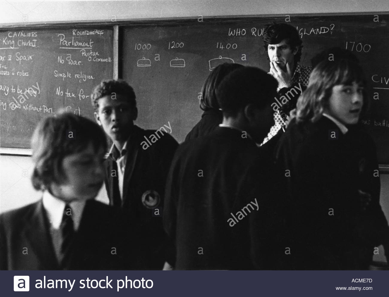 Teacher trying to handle a disruptive group of secondary school students - Stock Image