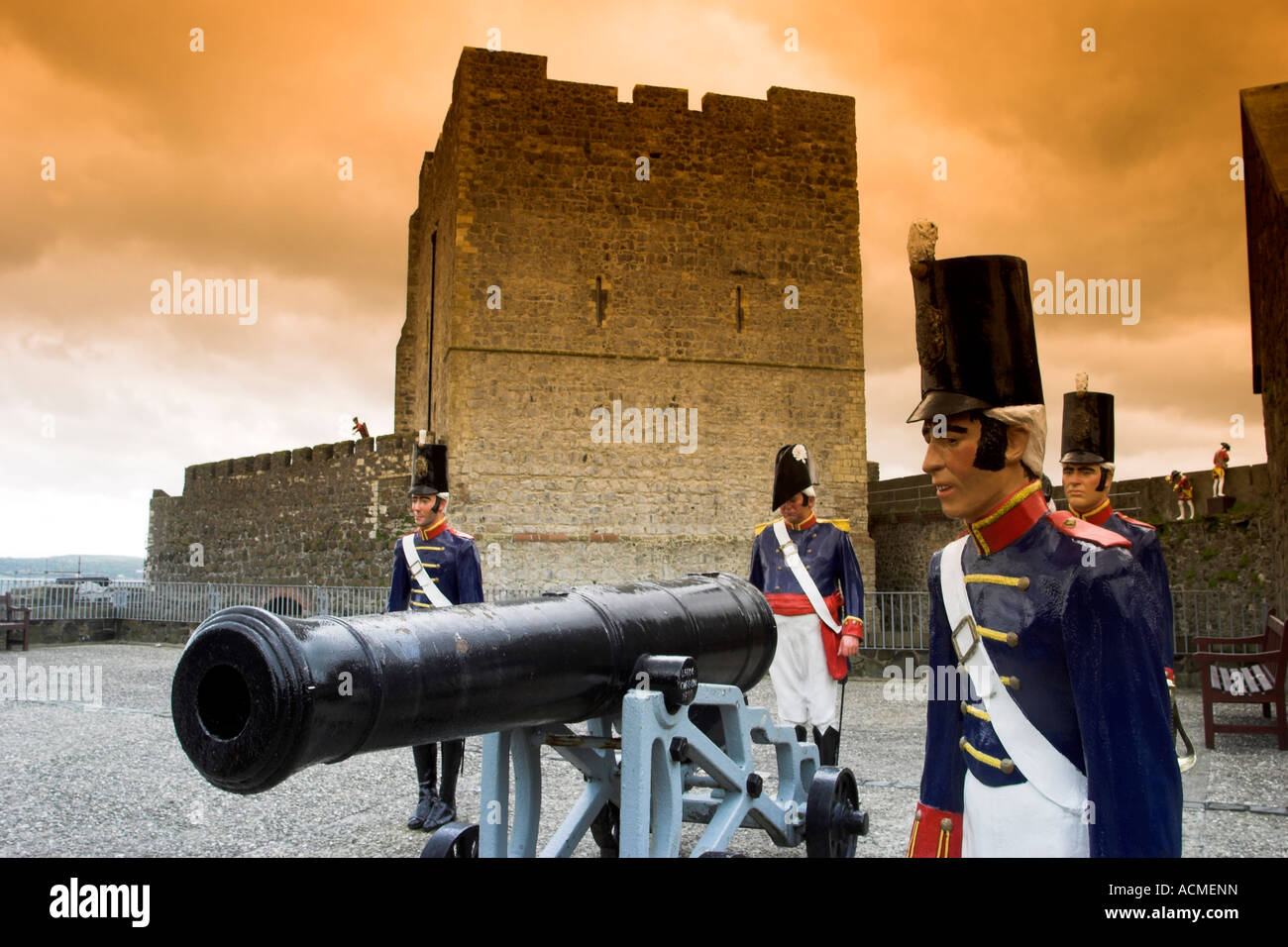 Early 19th century cannons and artillery men Located on the Grand Battery of Carrickfergus Castle Stock Photo