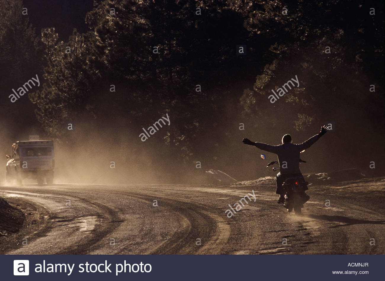 No hands, man riding motorcycle off into the distance Mt Lemmon Highway Tucson - Stock Image