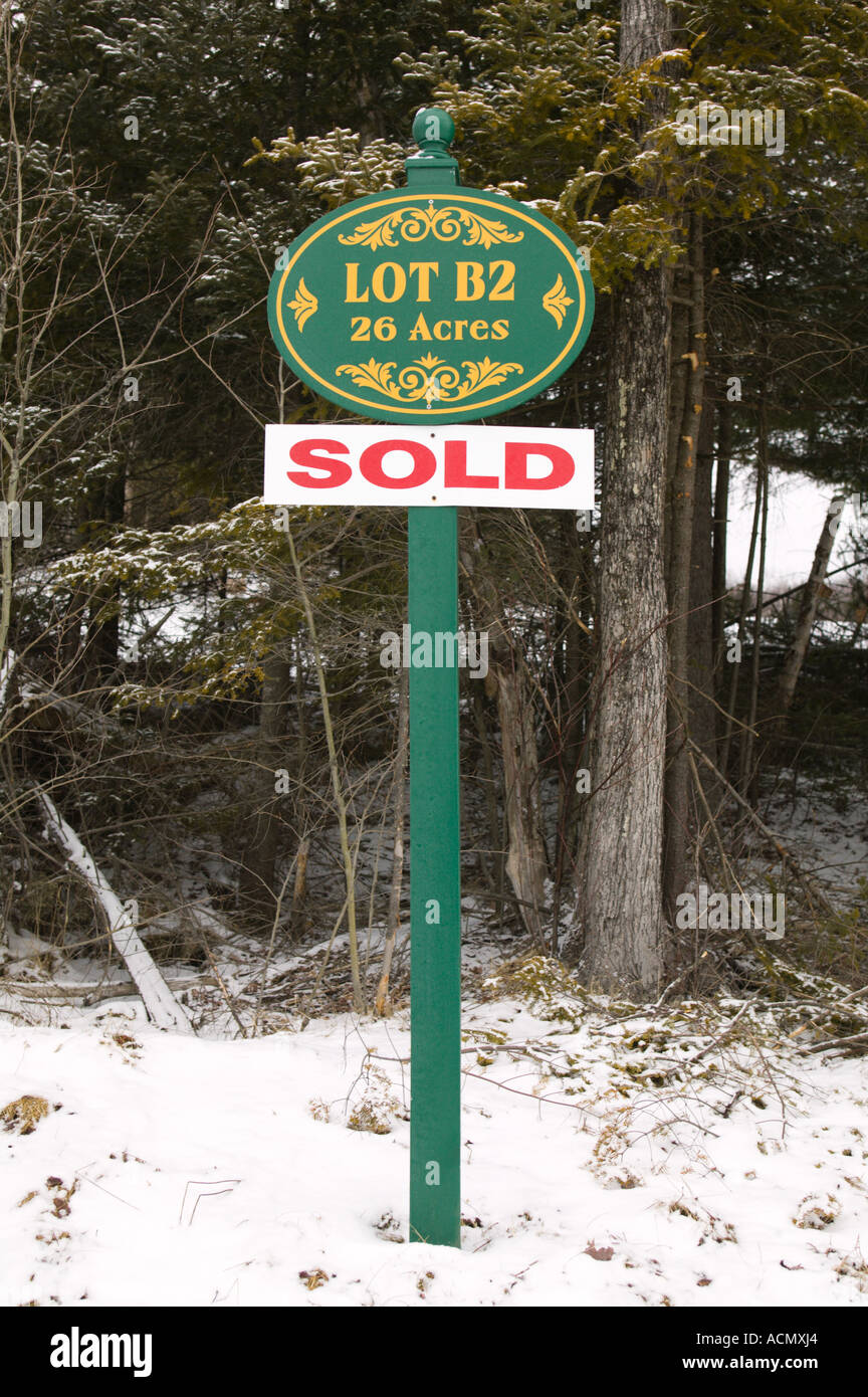 Sold Sign on Raw Land for Sale Lincoln New Hampshire Stock