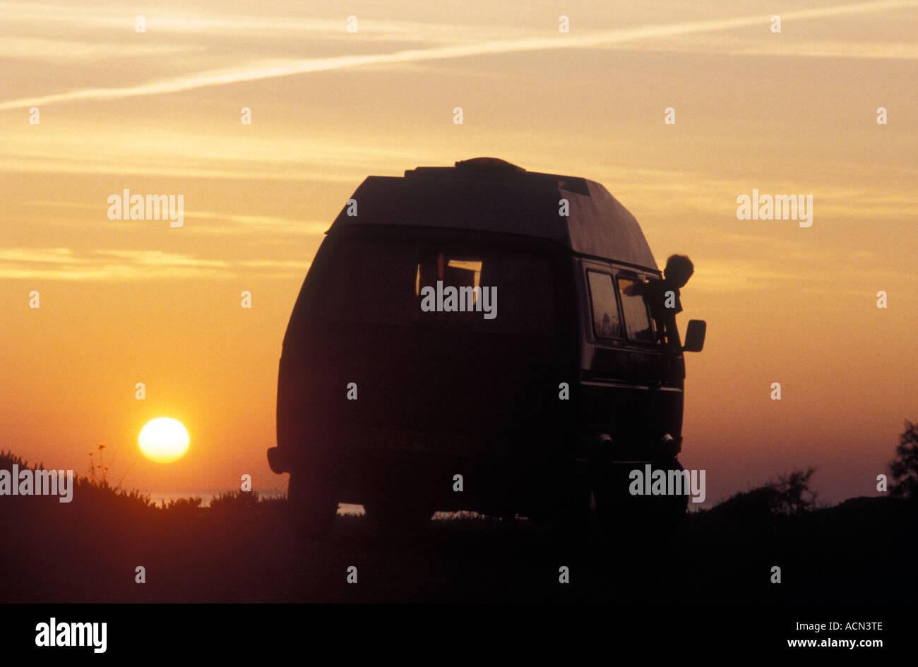 VW Kombi at sunset, photo by Bruce Miller - Stock Image