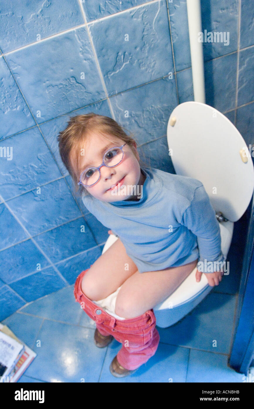 Little girl on the WC - Stock Image