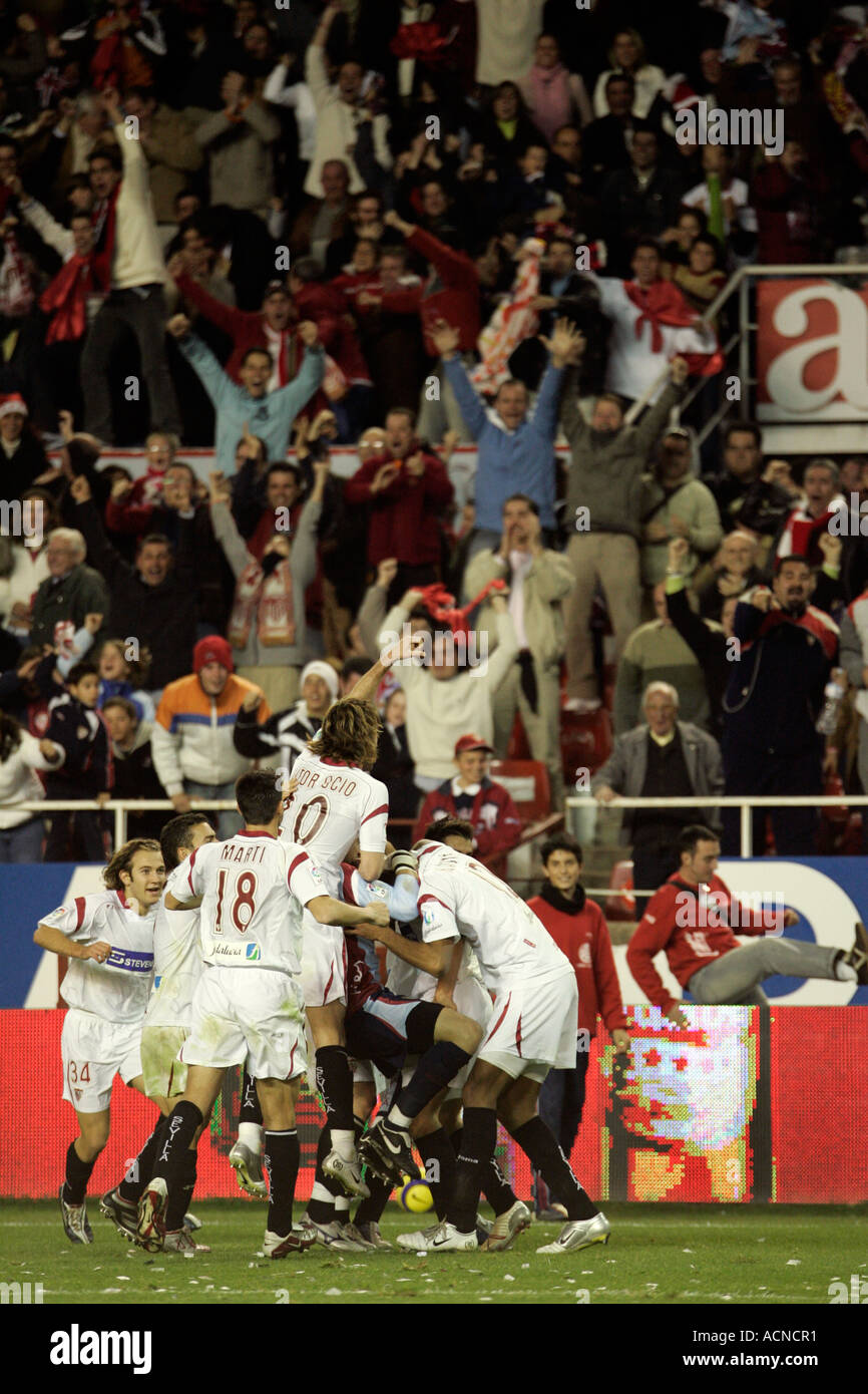 Sevillla FC players and fans celebrating a goal - Stock Image