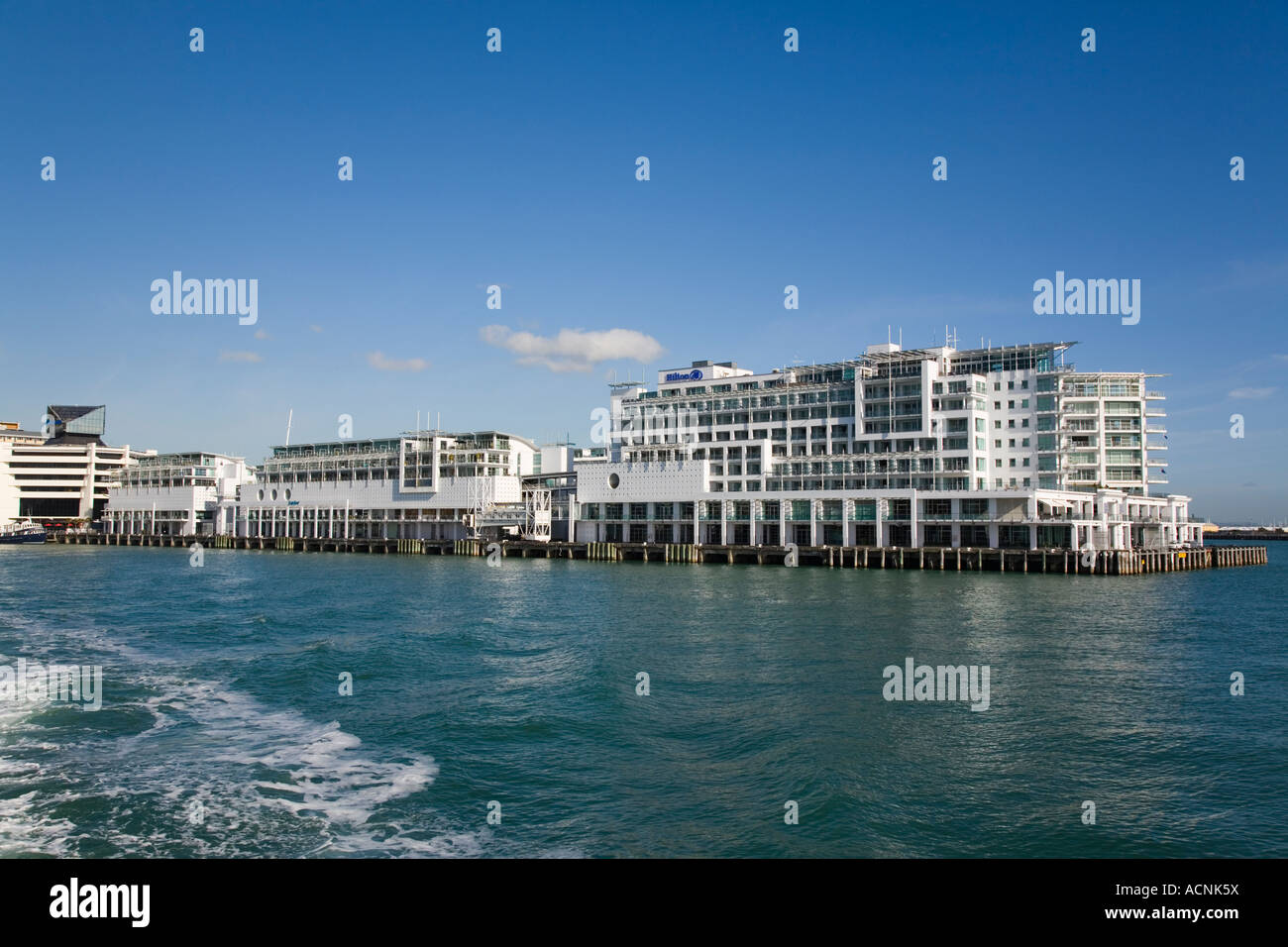 Wharf redeveloped with Hilton Hotel and Overseas Passenger Terminal cruise ship berth on eastern waterfront Waitemata - Stock Image