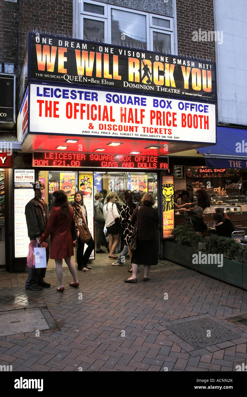 people queuing outside leicester square discount ticket booth in the early evening london england uk Stock Photo