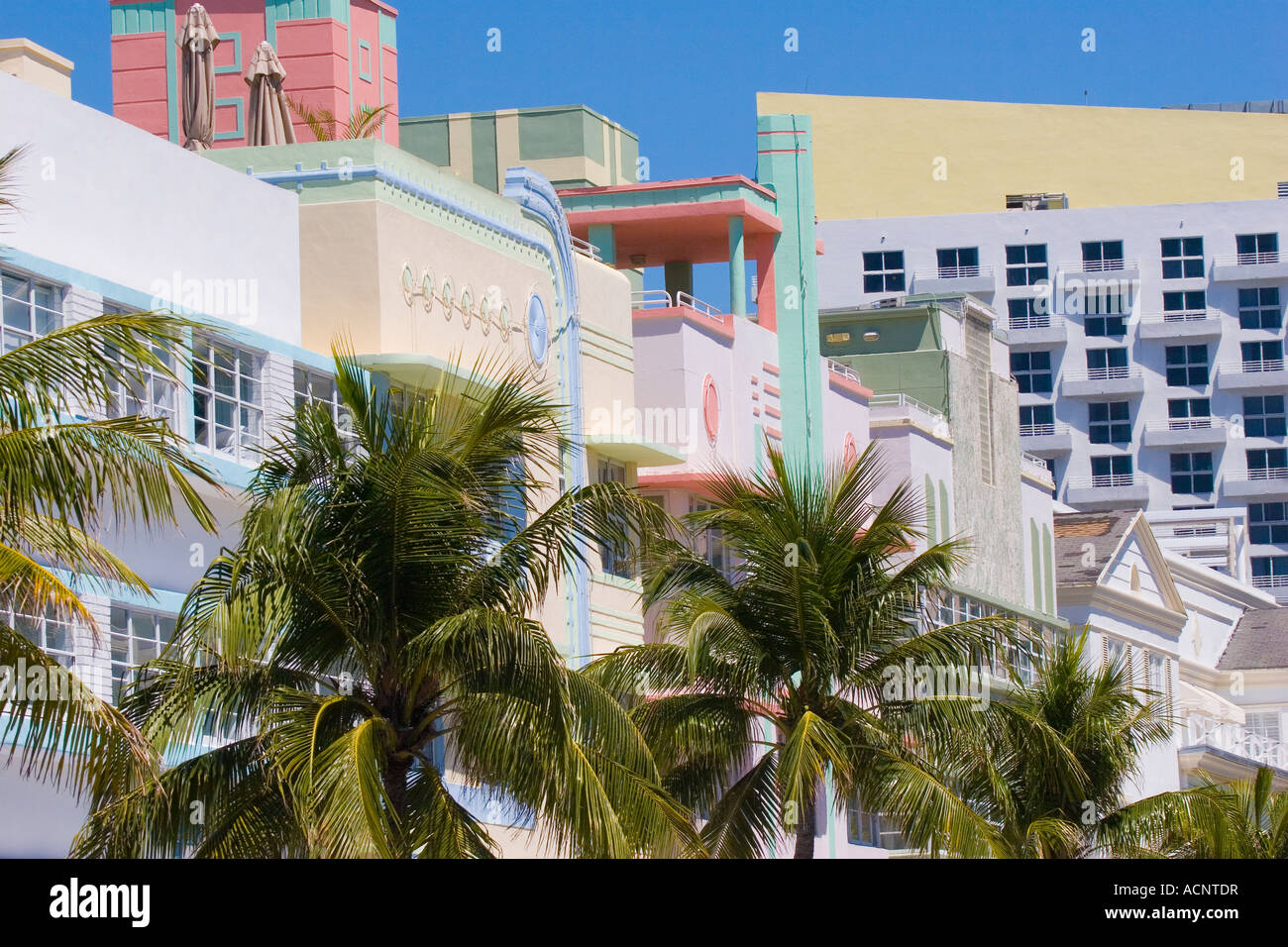 Row of pastel hotels in the art deco architecture style on Ocean Drive in the Art Deco District of South Beach Miami Stock Photo