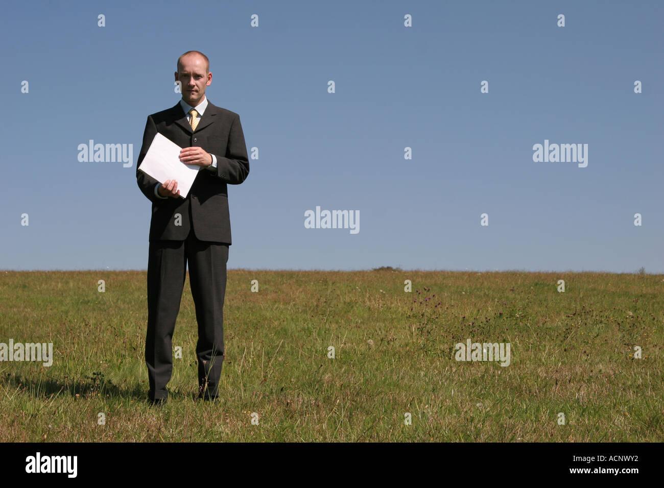 Businessman with annual report - Geschäftsmann mit Geschäftsbericht Stock Photo