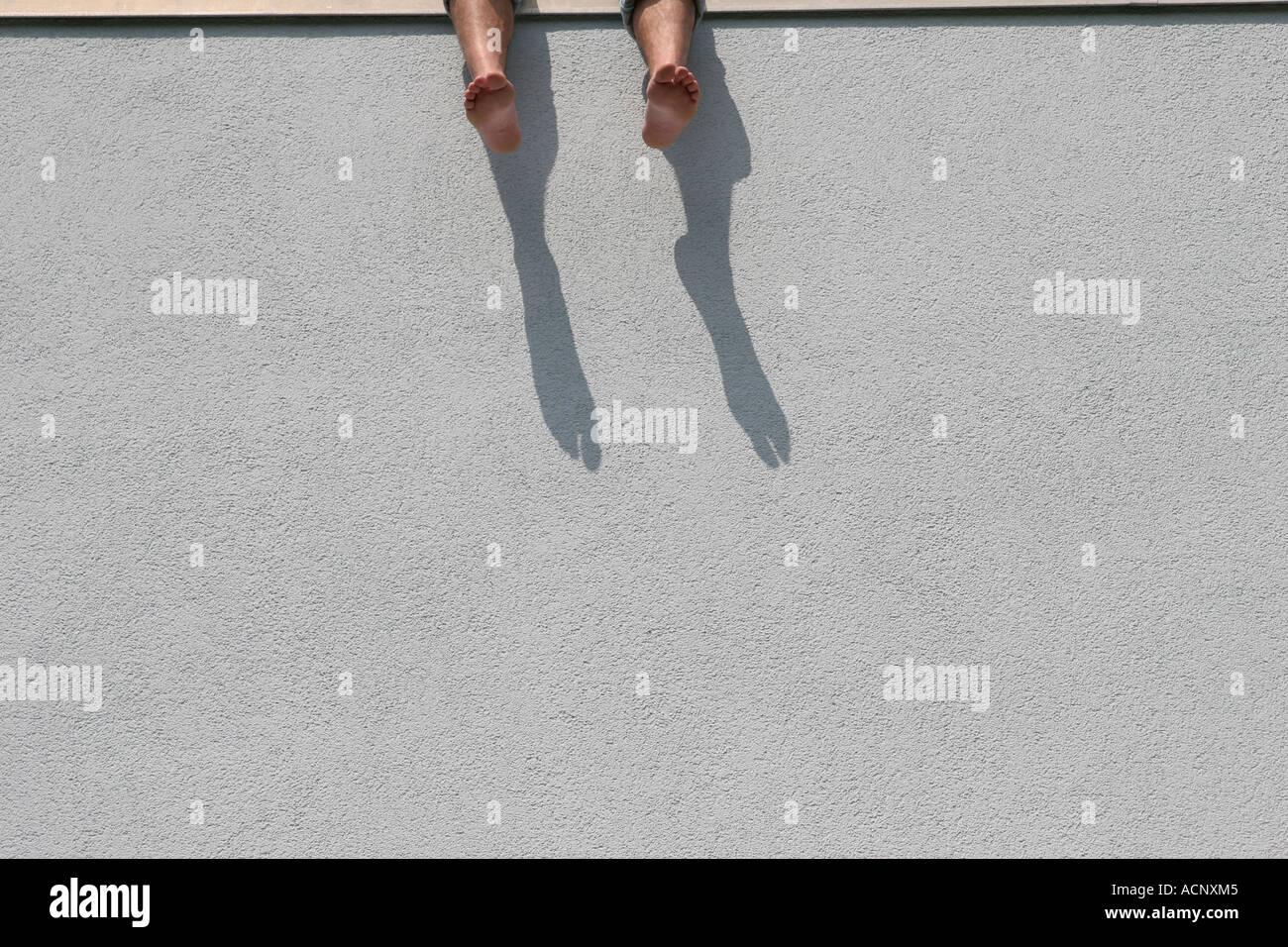 Dangle feet - Füße baumeln lassen - Stock Image
