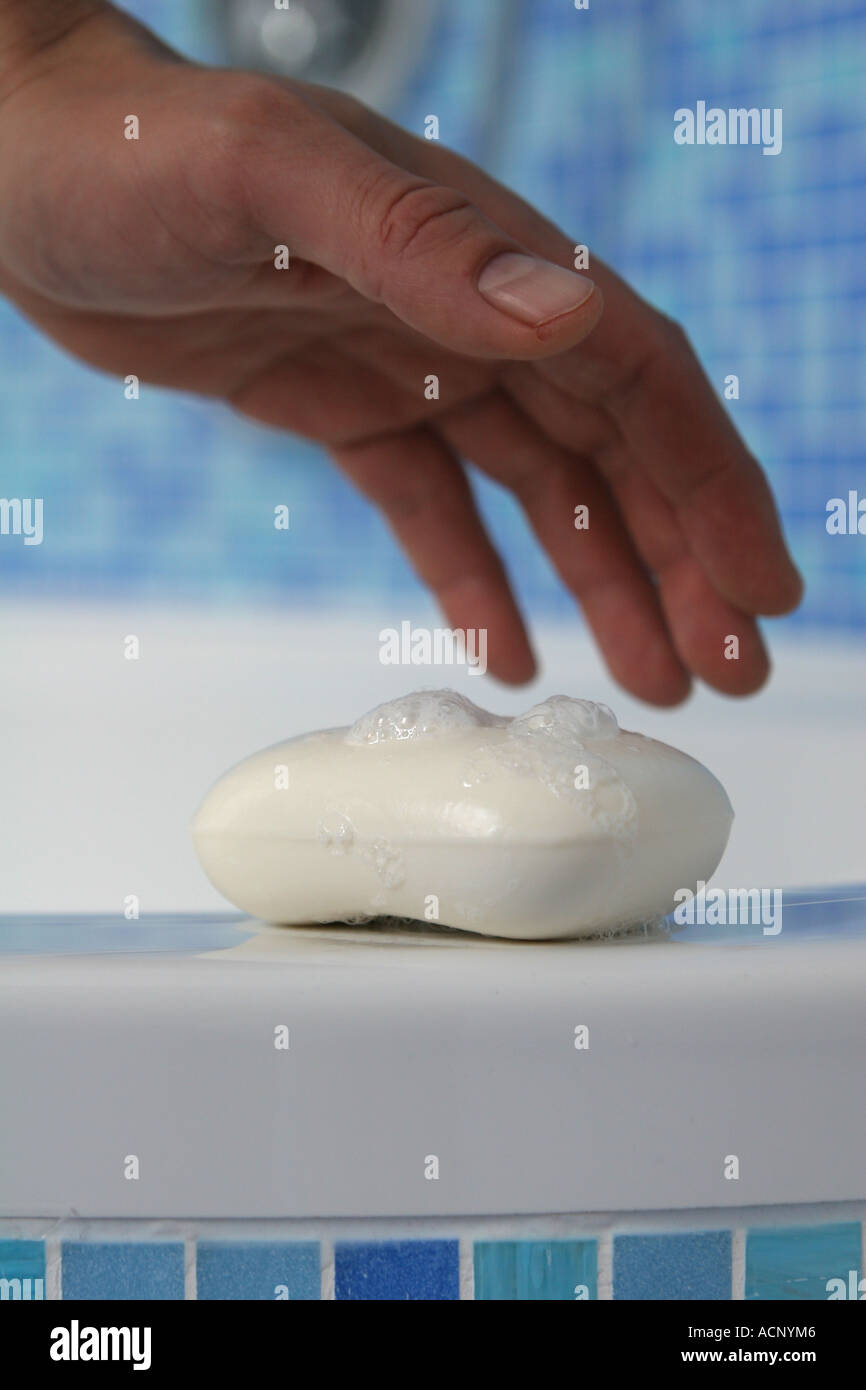 Soap with foam and a hand - Seife mit Schaum und Hand - Stock Image