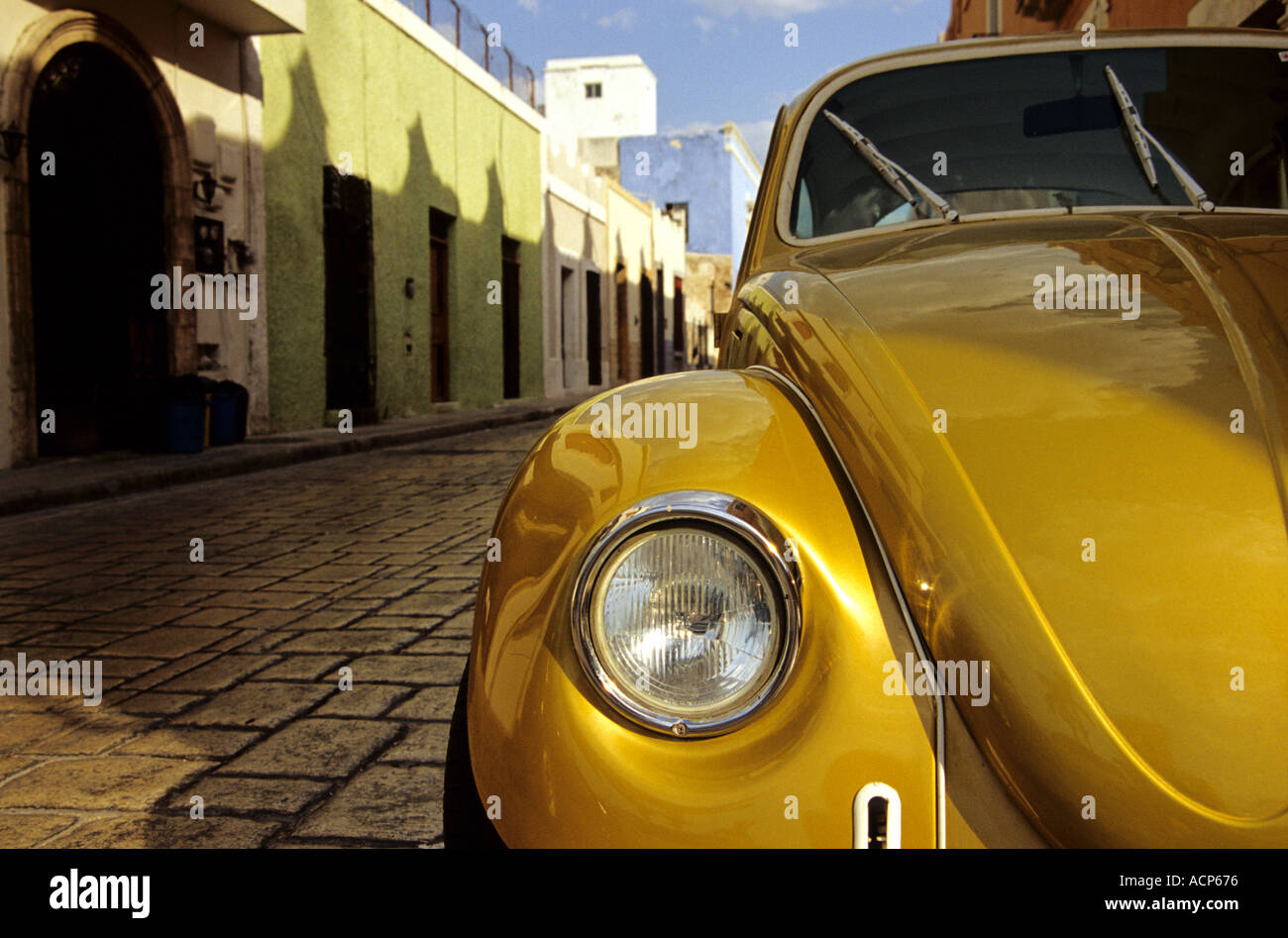 Old VW Beetle in a colorful street in Mexico May 2003 Stock Photo