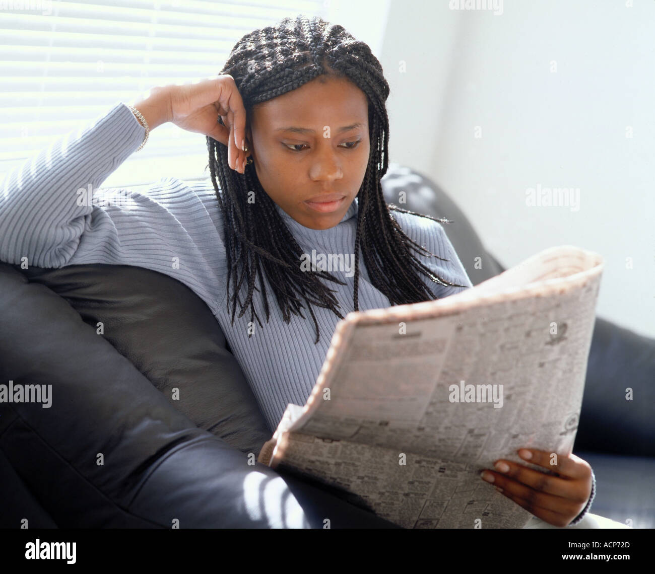 african american woman reading he news paper stock photo: 2451244