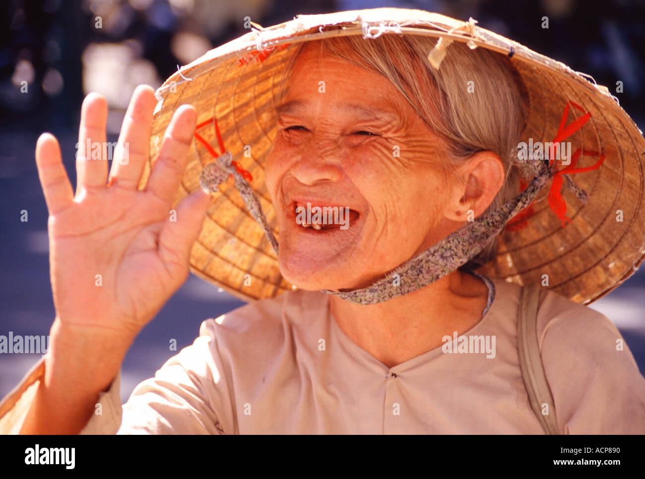 Black teeth vietnam stock photos black teeth vietnam stock images woman greeting tourists in vietnam stock image m4hsunfo