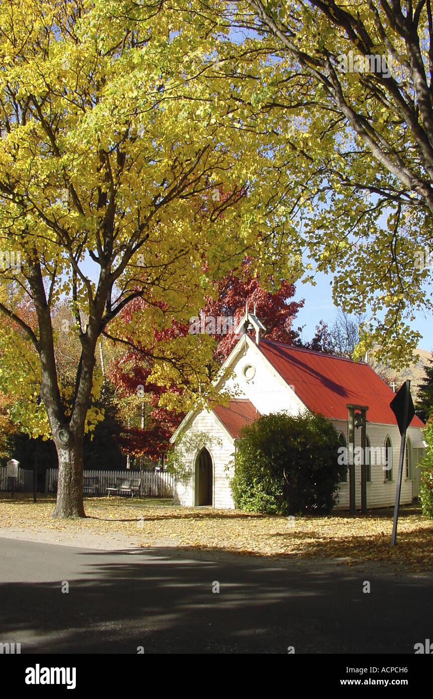 Autumn Leaves and chapel Arrowtown New Zealand - Stock Image