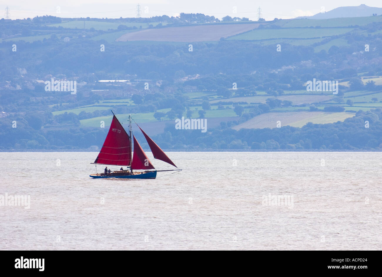Sailing in the Dee Estuary as seen from Hilbre Island - Stock Image