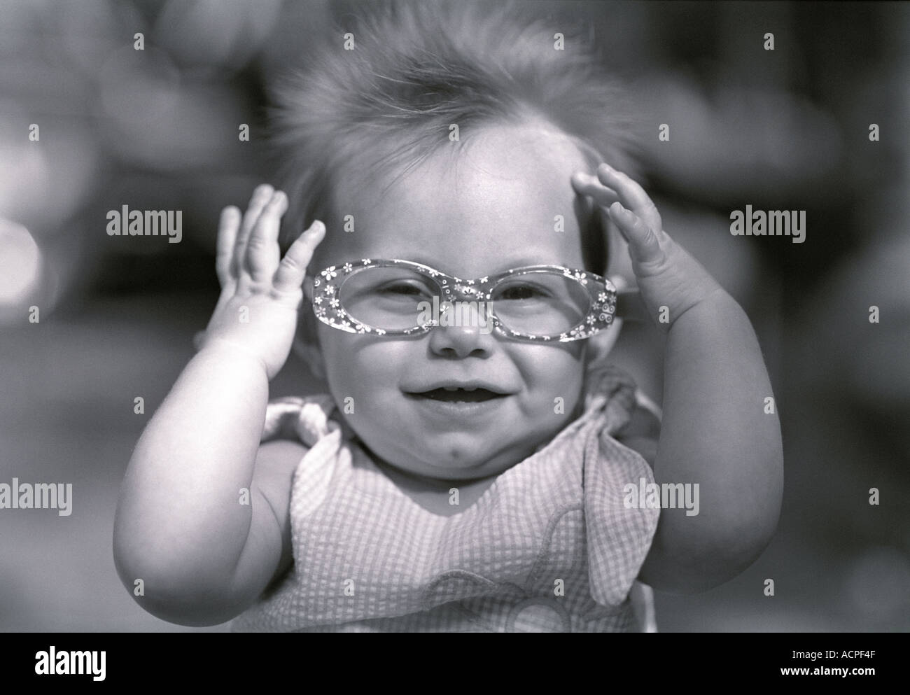 cute baby girl wearing funny glasses smiling stock photo: 2453326