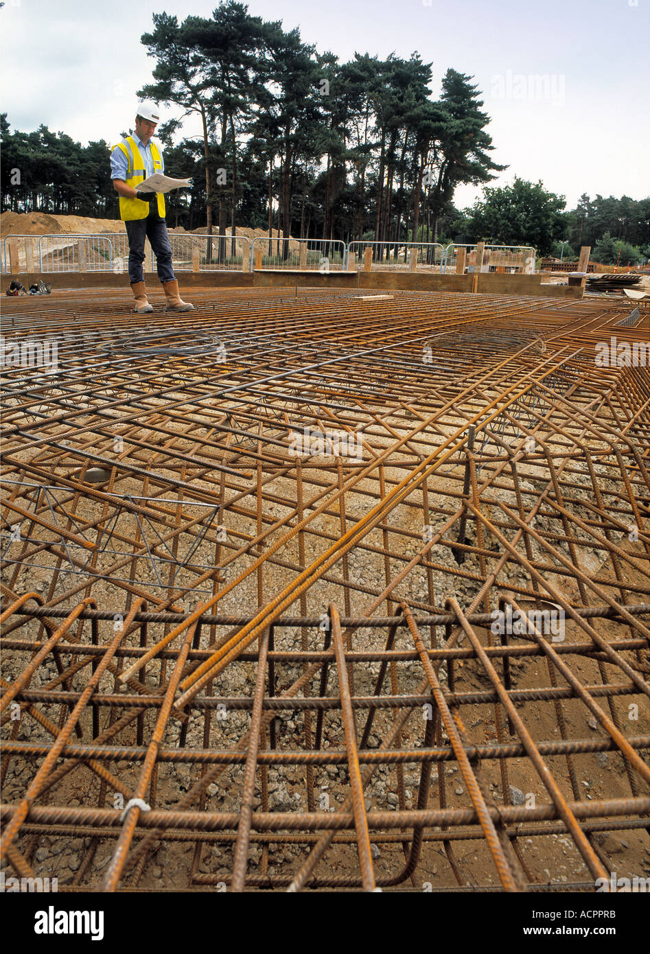 Inspecting the steelwork for a reinforced slab at a waste water treatment plant under construction. - Stock Image