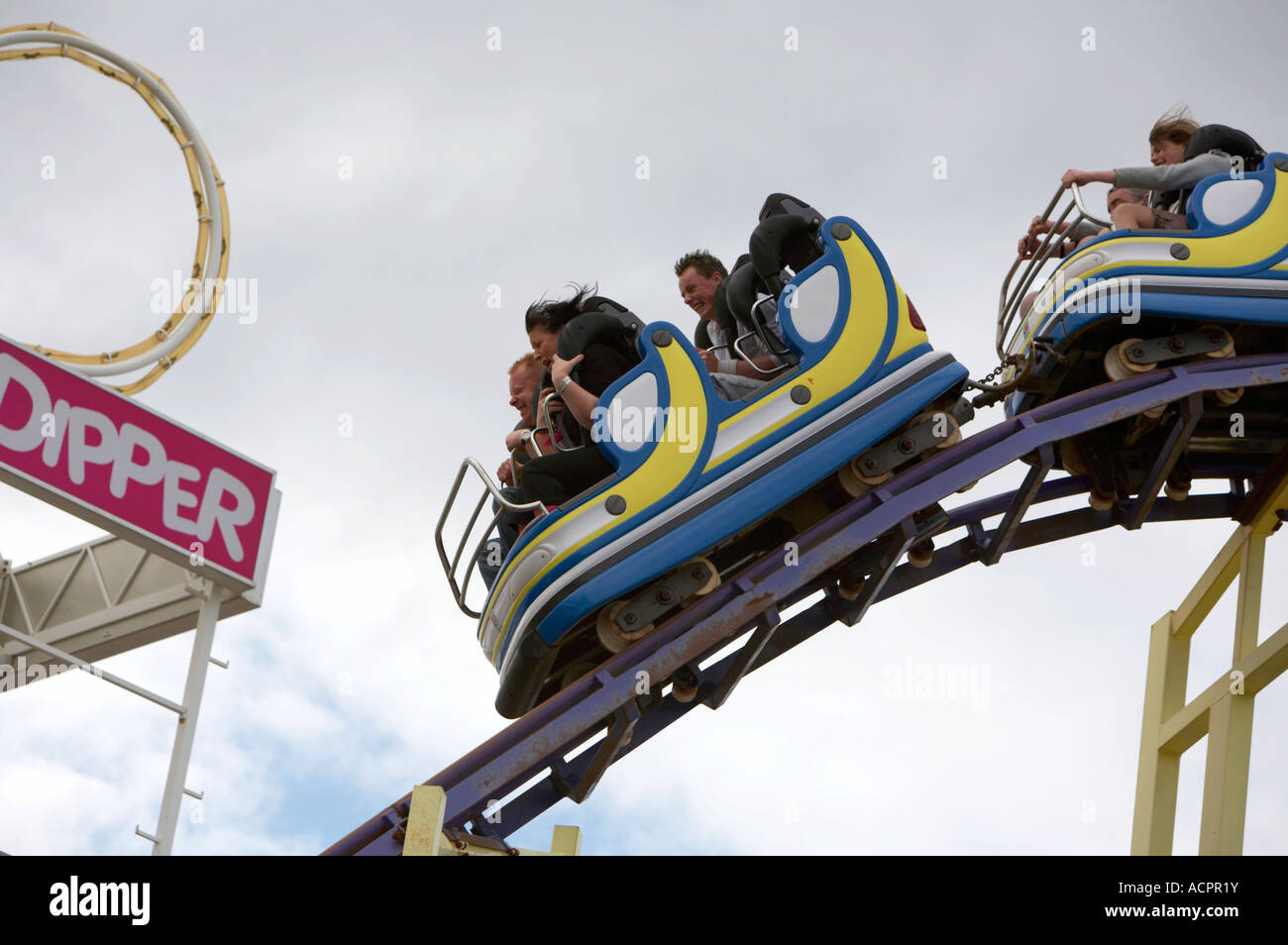 tourists and holidaymakers on the big dipper rollercoaster at Barrys amusements in Portrush - Stock Image